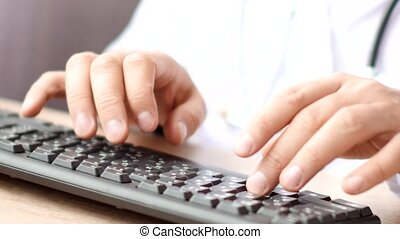 Medical doctor hands typing rx prescription on computer...