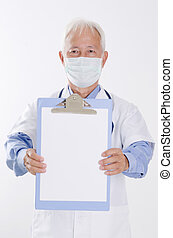 Medical doctor in face mask showing health report