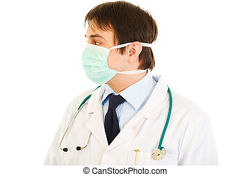 Medical doctor in mask  looking at copy space  isolated on white