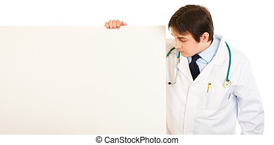 Medical doctor  looking at blank billboard isolated on white
