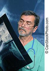 Medical Doctor radiologist reading Xray