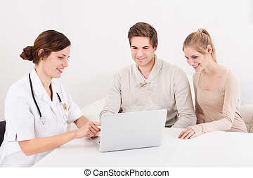 Doctor Showing Results To Patients