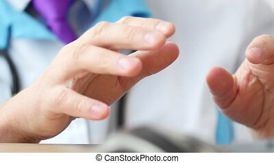 Medical doctor speaking with patient and explaining something close-up