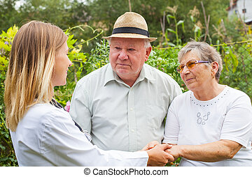 Medical doctor with elderly couple