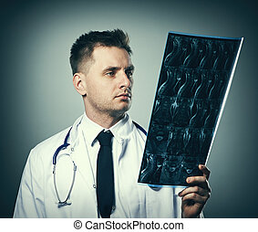 Medical doctor with MRI spinal scan