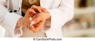 Medical doctor woman measuring pulse