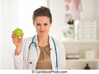 Medical doctor woman showing apple