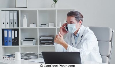 Professional medical doctor working in hospital office. Medicine and healthcare concepts.