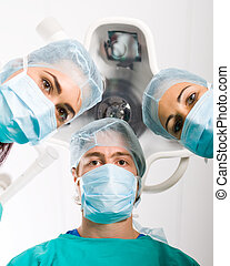 Medical doctors - Group of medical doctors in operation room
