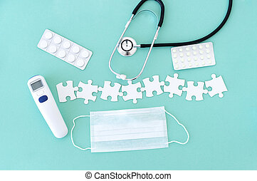 Medical equipment and puzzle pieces - Top view of medical ...