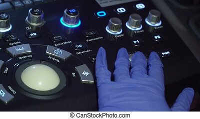 Medical equipment, ultrasound machine - Doctor's hand on the...