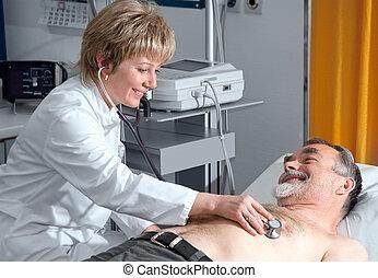 medical exam - doctor examining an elderly patient