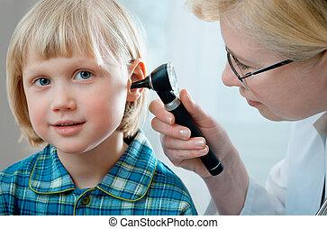 medical exam - female doctor examining little child boy