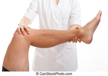 Medical examination of leg - Doctor examining the injured...
