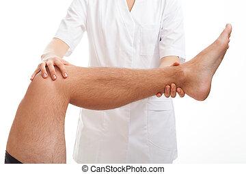 Medical examination of leg - Doctor examining the injured ...