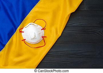 Medical face mask on the flag of Ukraine