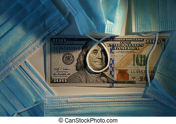 Medical face mask with 100 dollar bill. Like hanging on the gallows. COVID-19 coronavirus in USA. Financial crisis