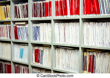 Medical files with patient information in doctor's office,