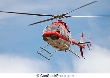 Medical Helicopter - Red and white medical helicopter in...