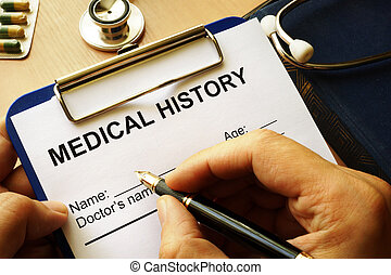 Medical history form in a clipboard.