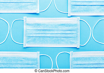 Medical hygienic mask, Face protective masks on blue background. Disposable surgical face mask protective against Coronovirus Covid-19,pollution, virus, flu. Healthcare medical surgical Flat lay pattern