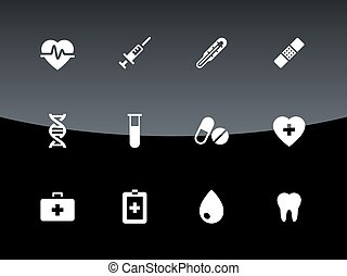 Medical icons on black background.