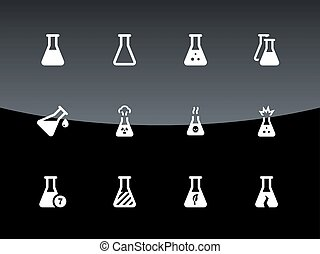 Medical lab flask icons on black background.