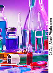 Medical laboratory glass equipment still life on blue purple