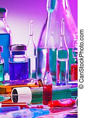 Medical laboratory glass equipment still life on blue purple