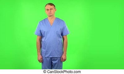 Medical man in anticipation of worries, then disappointed and upset. Green screen