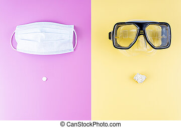 Medical mask with a pill and a diving mask with a sea shell on a contrast background. The only right mask for summer vacation in 2020 during the Coronavirus pandemic and the tourism industry crisis.