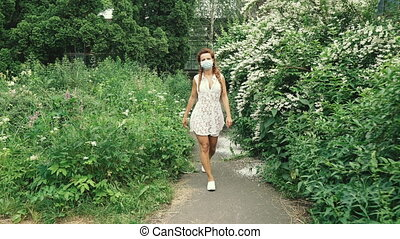 Medical mask. Young woman in a medical mask.