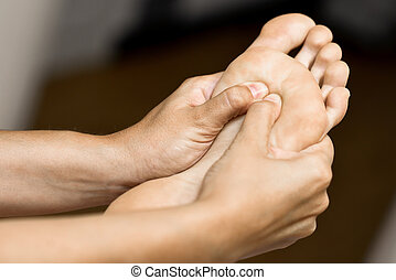 Medical massage at the foot in a physiotherapy center....