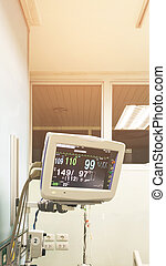 Medical monitor machine in icu room show vital sign of the patient.