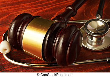 Medical negligence. Gavel and stethoscope. Malpractice...