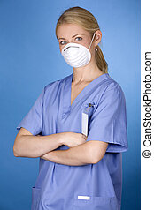 medical nurse - blond healthcare worker wearing blue scrubs...
