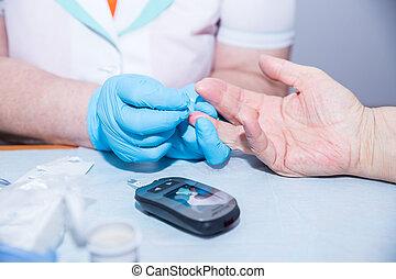 Medical nurse measuring the blood sugar with modern medicine...
