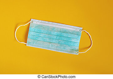 medical or surgical mask - protective face mask on yellow background