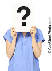A woman in medical scrubs holding a signboard with a question mark