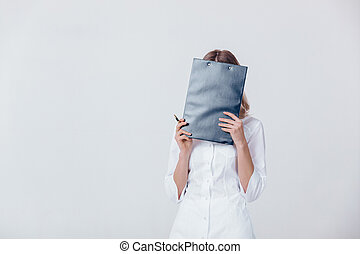 Medical physician doctor woman in white coat holds folder