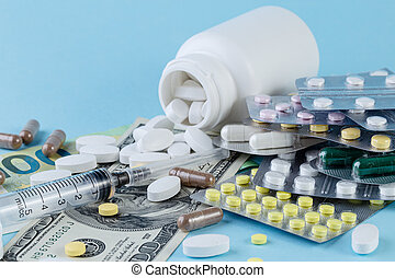 Medical pills are on a money on a blue background. Medicine concept.