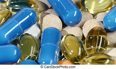 Medical pills, tablets and capsules, rotation, close up