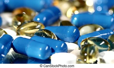 Medical pills, tablets and capsules, rotation, reflection, close up