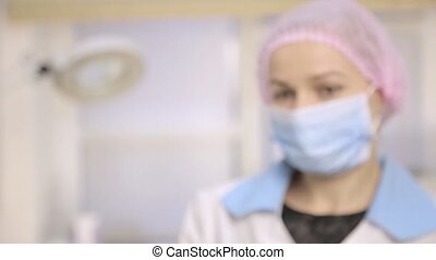 medical professional in white coat and protective gloves...