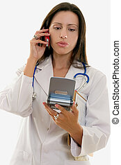 Healthcare worker relating information over the phone.