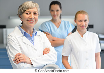 Medical professional team woman at dental surgery