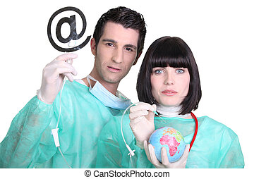 Medical professionals with at sign and globe