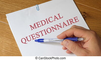Medical questionnaire on a wooden table