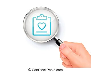 Medical record icon showing through by magnifying glass held...