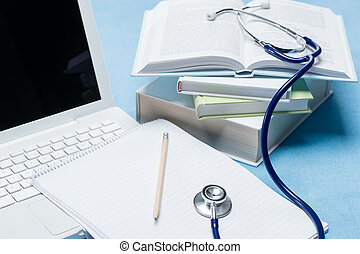 Medical research stethoscope lying on doctor book pen and paper